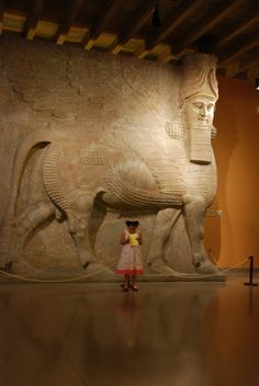 human headed winged bull from Khorsabad, Mesopotamia (16 feet tall!), that once stood in the throneroom of the palace of the Assyrian King Sargon II.
