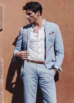 love everything about this: off-color shirt buttons, thin belt, high waisted pants, unstructured blazer