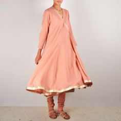 Light Pink Angarakha Anarkali Suit Angarakhas need not be set aside as wedding wear. This cotton voile kurta set is subtle and dashing enough to be worn as formal wear on occasions that demand dressing up just so lightly. The slight whisper of shiny edging and delicate tassels lend the ensemble loads of festive charm. Shop here: http://www.tadpolestore.com/radhas-daughters #suits #angrakha #summery