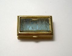 Vintage Gold Roman/Greek Scene Carved Glass Top Pill Box