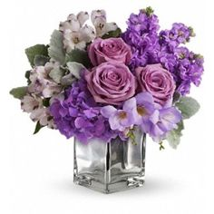 Florist in Las Vegas Flower Delivery - A pretty mix of lavender spray roses, purple stock and hydrangea are nestled in a lush mix of greens in a cube.   - Lovely Lavender