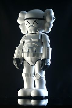 stormtrooper companion - by KAWS - photo specs : 2 light sources from the sides opposite of each other, in a dark room, a black background, & the subject is on a black reflective surface. Good for light colored toys.