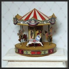This papercraft is aCarousel (Merry-go-round) Miniature, created by nadsa. You can download the template here: Carousel Miniature Free Papercraft Download
