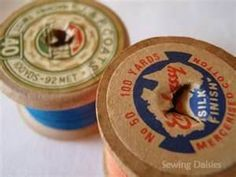 Old wooden spools of thread.  Now they are plastic.