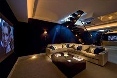 Basement ~ I love the deep rich color on the walls.
