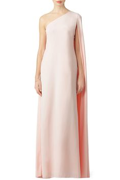 A cape sleeve makes this blush pink Jill Jill Stuart prom gown dramatic.   Also available in red and pink.
