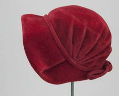 1948 red velvet, bonnet style hat, Christian Dior, Paris.