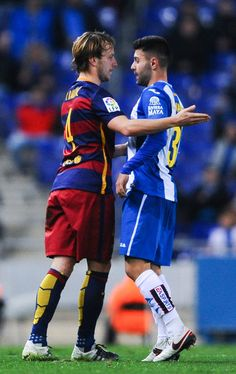 Ruben Duarte argues with Ivan Rakitic of FC Barcelona during the Copa del Rey Round of 16 second leg match between RCD Espanyol and FC Barcelona at the Power8 stadium on January 13, 2016 in Barcelona, Catalonia.