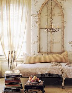 Cool arched window as headboard ... (I think I would literally scream if i found a cool window like this - at a price I could afford)...