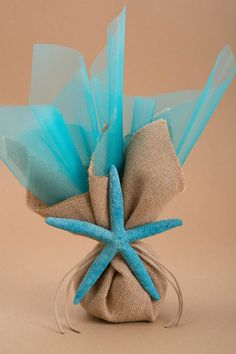 Burlap, tulle & starfish wedding favor idea.