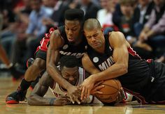 Norris Cole #30 (L) and Shane Battier #31 of the Miami Heat battle for a loose ball.