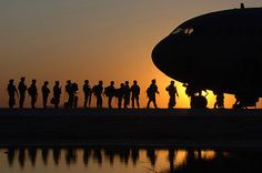 The sun sets behind a C-17 Globemaster III Nov. 17 at Joint Base Balad, Iraq, as Soldiers begin boarding. C-17s can carry payloads up to 169,000 pounds and can land on small airfields. The C-17 is deployed from the 437th Airlift Wing at Charleston Air Force Base, S.C.
