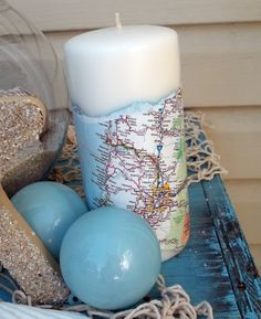 "Super fast and easy map candles. Simply tear a strip of map long enough to wrap around the base of the candle and mod podge it onto the candle. Anyone know what ""mod podge"" means? Map Crafts, Arts And Crafts, Travel Crafts, Going Away Parties, Travel Themes, My New Room, Candle Making, Pillar Candles, Unity Candle"