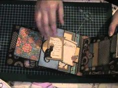 ▶ steampunk spells album - YouTube (lots of neat ideas here - glossy finish covers, magnets to hold tags in, spell idea, lots of pockets/flaps and mini books)