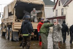 Maryland National Guard members were deployed to Crisfield, MD to assist in house-to-house evacuations.