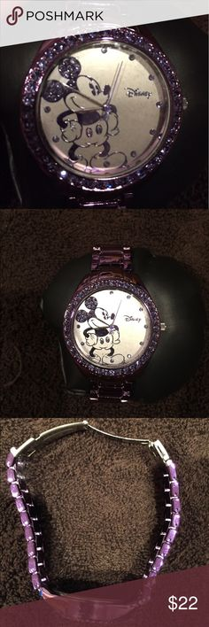 New in the box gorgeous purple mickey watch New in the box gorgeous purple mickey watch.  Pretty sparkles around the face.  Needs a battery. Disney Jewelry
