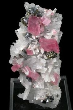 Four naturally occuring mineral crystals together. Rhodochrosite, Quartz, Pyrite, Galena from Colorado by John Betts. (From the famous, now gone, Sweet Home Mine) by marci