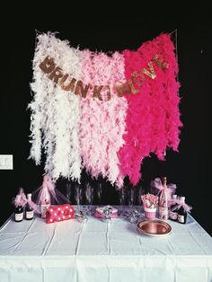 feather boa backdrop and banner - with a champagne / mimosa bar