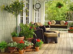 Love the front porch.  Must haves:  swing(s) and comfy rocking chairs.