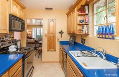 Love this condo kitchen blue tops. The tops alone make it pop!!!