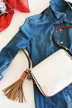 One of Jeanne Chan, the San Francisco-based lifestyle blogger of @ShopSweetThings favorite Fossil x ME to WE pieces? The leather Tassel bag charm with beaded accents.