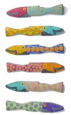 fish wall art made out of picket fences, I would use them to make the pickets on a railing inside a beach house. Stairwell maybe?