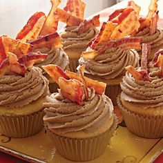 Maple Bacon Cupcakes Recipe Desserts with butter, sugar, large eggs, soft-wheat flour, baking powder, salt, milk, vanilla extract, vegetable oil cooking spray, butter, dark brown sugar, evaporated milk, baking soda, light corn syrup, powdered sugar, maple flavoring, bacon slices
