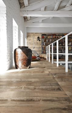 Beautiful indoor flooring using concrete look tiles new to Signorino Tile Gallery. These tiles combine elements of stone, wood, concrete and cement, resulting in a truly unique aesthetic.