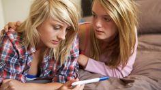 Teenagers take pregnancy test (Shutterstock)