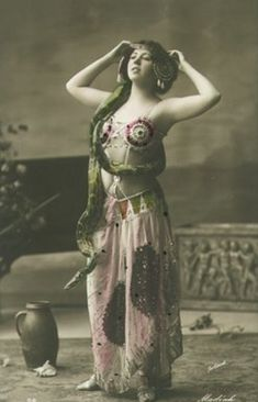 Turn of the century snake charmer