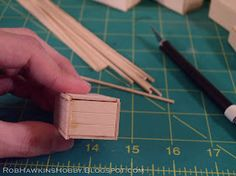 Here's a quick tutorial on how I build crates using a block of foam, with basswood texture glued overtop. The solid construction ensures th. Ho Scale Train Layout, Train Layouts, Matchstick Craft, Fantasy Art Landscapes, Military Diorama, Homemade Tools, Miniature Houses, Model Building, Model Trains