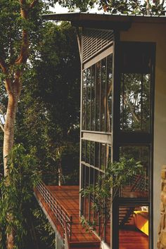 Et.. if you timber clad the upstairs balcony space including decking the floor space you could create this visual effect