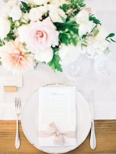 Classic floral filled table decor: http://www.stylemepretty.com/canada-weddings/british-columbia/osoyoos/2016/05/23/this-vineyard-wedding-maruqee-proves-love-is-all-you-need/ | Photography: Christie Graham Photography - http://www.christiegrahamphotography.com/