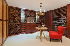 Sunset melamine wine system has five different kinds of wine storage, a bar with stemware rack and glass display shelves for specialty liqueurs.