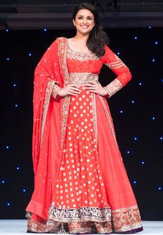 Actress Parineeti Chopra walked the ramp in an ornate red anarkali lehengas for the show at the Grosvenor House Hotel in London's Park Lane, in aid of The Angeli Foundation #Bollywood #Fashion