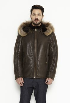 Hooded coat for men, made from lamb fur and natural raccoon fur. The jacket hood is made from lamb fur but the contour of the hood has raccoon fur.