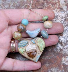Gaea Ceramic Bead and Art Studio Blog - Original ceramic acorn and blue bird heart pendant and bead set.