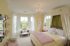 Warm yellows just seem to always work in a traditional setting. In this pretty bedroom, a pale yellow tint creates a space that is light and airy.Suggested paint pick: Morning Sunlight,Try  #6693 Lilly by Sherman Williams