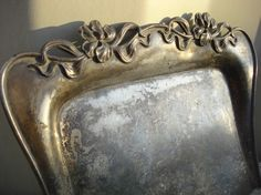 Such a gorgeous silent butler, crumber, crumb catcher, crumb tray or table valet. Made by the Eureka Silver Co of Meriden, CT. Quadruple plate item 908.  This lovely piece done in the Art Nouveau style was popular in the late 1800's through the early 1900's. Graceful, curvy lines adorned with beautiful Irises make this simply elegant.  ~*~SOLD