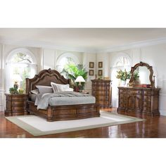 Enhance your home decor with this elegant Montana 6-piece platform king-size bedroom set. This set has a generously padded upholstered headboard with nail head trim, and includes a king-size bed, two