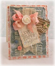 handcrafted shabby chic card ... corals, vanilla, kraft and gray ... seam binding multi-loop bow ... frayed burlap ribbon .. lace ... button and more ... delightful card!!
