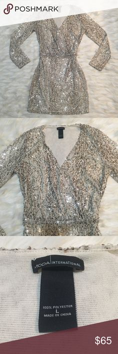 MODA INTERNATIONAL VICTORIAS SECRET SEQUIN DRESS Beautiful sequin dress in cream and brown. Bought from the Victoria's Secret catalog. Like new condition and a size large. Super sexy with a cinched waist and v cut chest. Perfect for holiday parties and New Years! Moda International Dresses Mini
