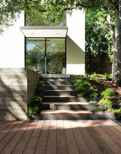 concrete step retaining walls, backfilled, planted and decked to create a stairway that blends with grade