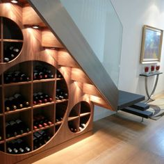 Under stairs space shouldn't be left unused, it's not a dead space! For those of you who love wine we've gathered cool ideas to organize a wine cellar or some simple wine storage space there.