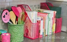 Cookbook organization in kitchen ~Would I EVER have enough counter space to do this?  Love how it looks, though.