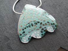 Pendant in sterling silver and aqua enamel, leaves pattern.. $295.00, via Etsy.