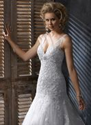 Ella - by Maggie Sottero. I'm not sure if this is my fav, but I think the shape would look good on me.
