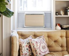 """The new modern July window air conditioner unit is a promising attempt to make ACs look genuinely """"cool"""" and easier to install. Air Conditioning Units, Window Unit, Minimalist Interior, Heating And Cooling, Wood Veneer, Window Air Conditioner Cover, Air Conditioners, Windows, Pure Products"""