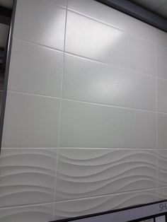 White wall tile with feature wave tile White wall tile with working wave tile