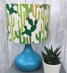 Cacti Design Fabric Covered Lampshade. by Lightflightlighting on Etsy https://www.etsy.com/listing/270384933/cacti-design-fabric-covered-lampshade